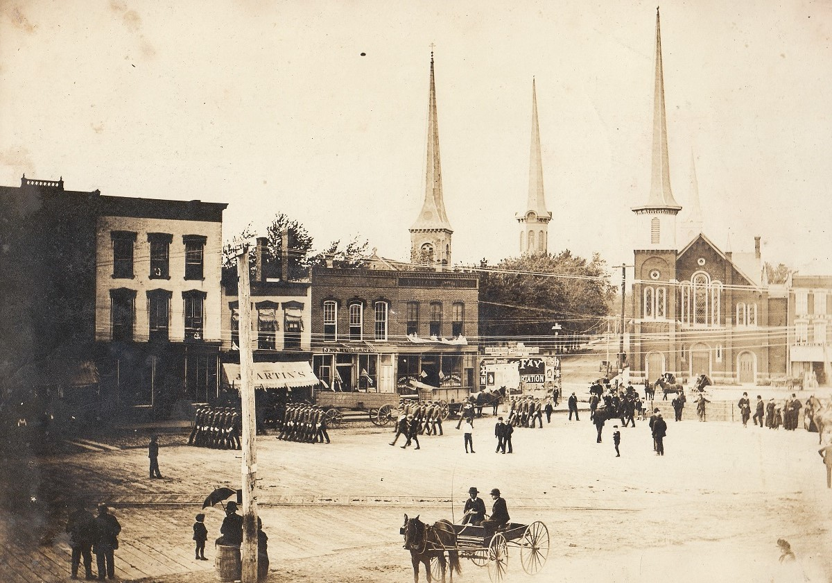 The steeples of four of the five Lockport churches on Niagara and Church Streets c. 1890. From left to right, First Free Congregational Church, First Presbyterian Church, Methodist Episcopal Church, and St. Patrick's Catholic Church (very faint in the background).
